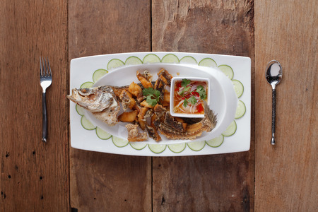 Fried Seabass with garlic,On table.JPG