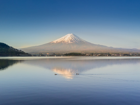 Mountain Fuji reflected in Kawaguchiko lake with city view from drone shot on a sunny day and clear sky Stock fotó