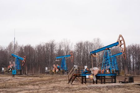Green Oil pump oil rig energy industrial machine for petroleum crude. oil crisis. Russia pumps oil pollution Foto de archivo