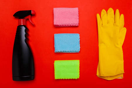 black wiper gloves and rags on a red background. Copyspace