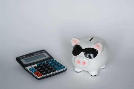 financial airbag for a future good life. piggy bank with calculator on a white background