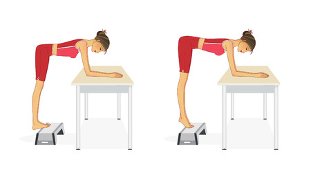 A young woman performs exercises to strengthen the calf muscles by matching to the table and using a step-platform. Isolated on white background
