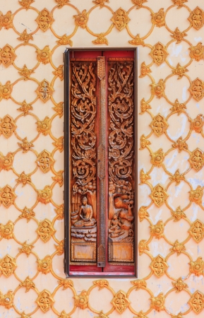Ancient carving wooden window of thai temple photo