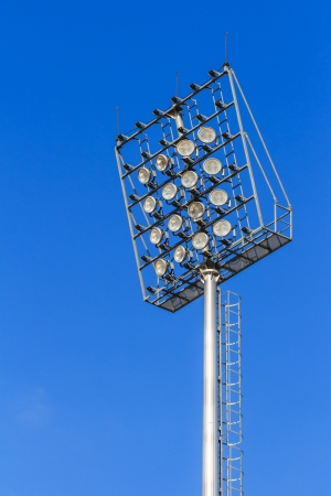 Stadium light on blue sky photo