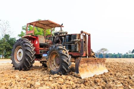 grader: Old red grader bulldozer Stock Photo