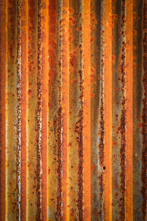 Rusty corrugated iron metal fence Zinc wall texture background photo