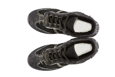 Black sneakers isolated on white background photo