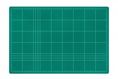Cutting mat isolated on white background photo