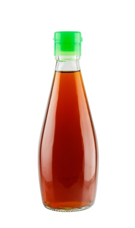 Fish sauce in glass bottle isolated on white background Фото со стока