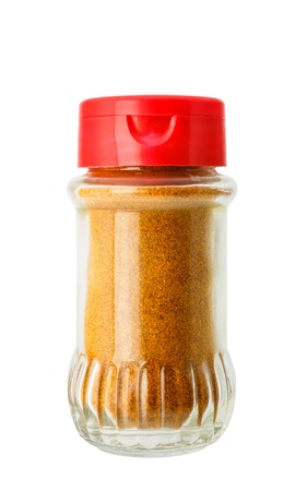Ground chili in glass bottle isolated on white background photo