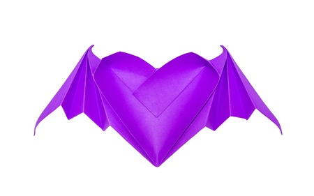 Origami heart with bat wings isolated on white background photo