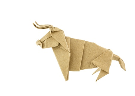 Origami bull recycle paper isolated on white background photo