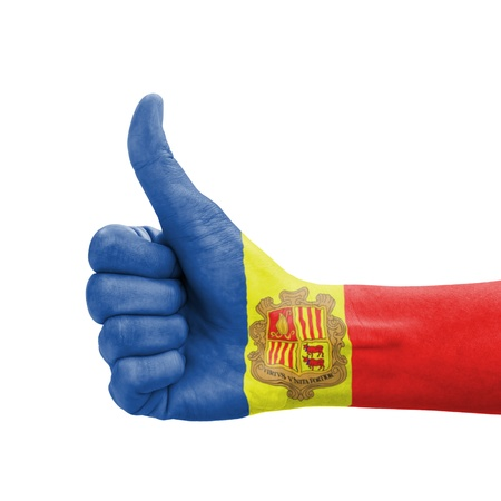 tourism in andorra: Hand with thumb up, Andorra flag painted as symbol of excellence, achievement, good - isolated on white background Stock Photo