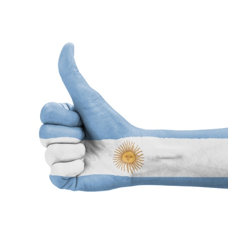 Hand with thumb up, Argentina flag painted as symbol of excellence, achievement, good - isolated on white background photo
