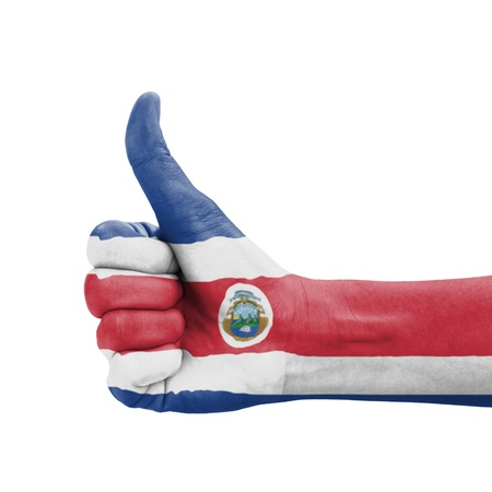 Hand with thumb up, Costa Rica flag painted as symbol of excellence, achievement, good - isolated on white background photo