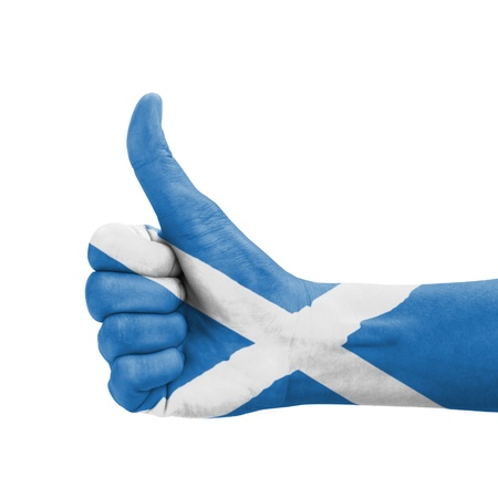 Hand with thumb up, Scotland flag painted as symbol of excellence, achievement, good - isolated on white background photo