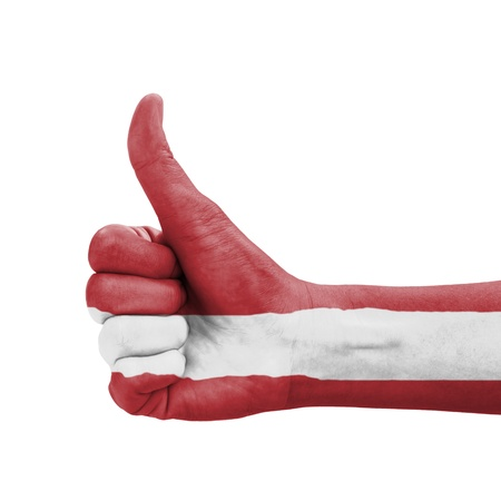 Hand with thumb up, Latvia flag painted as symbol of excellence, achievement, good - isolated on white background photo