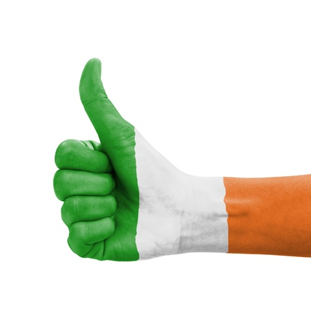 Hand with thumb up, Republic of Ireland flag painted as symbol of excellence, achievement, good - isolated on white background photo