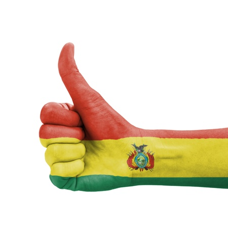 Hand with thumb up, Bolivia flag painted as symbol of excellence, achievement, good - isolated on white background photo