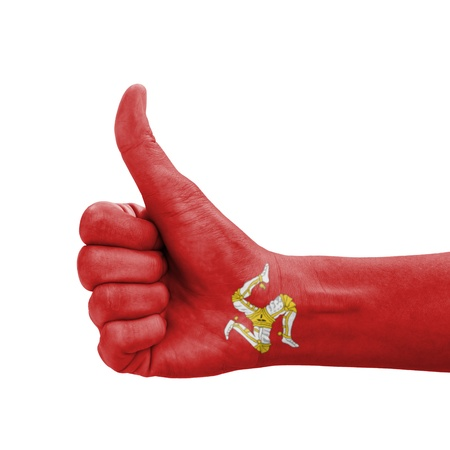 Hand with thumb up, Isle of Man flag painted as symbol of excellence, achievement, good - isolated on white background photo
