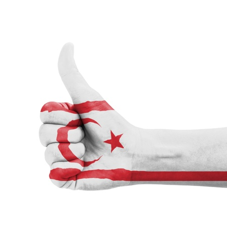 Hand with thumb up, Northern Cyprus flag painted as symbol of excellence, achievement, good - isolated on white background photo