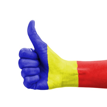 Hand with thumb up, Romania flag painted as symbol of excellence, achievement, good - isolated on white background photo