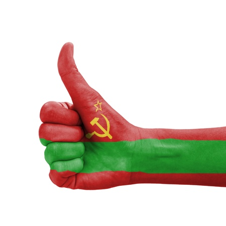 Hand with thumb up, Transnistria flag painted as symbol of excellence, achievement, good - isolated on white background photo