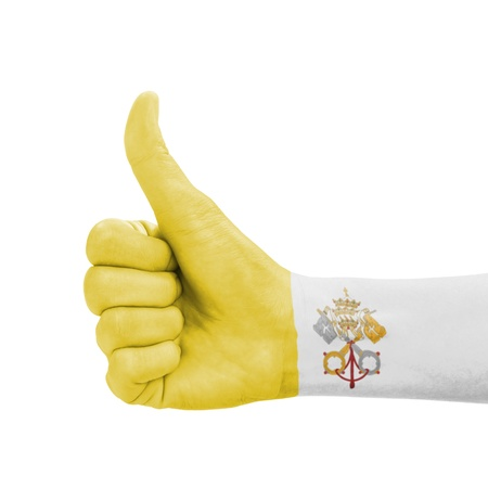 Hand with thumb up, Vatican City flag painted as symbol of excellence, achievement, good - isolated on white background photo