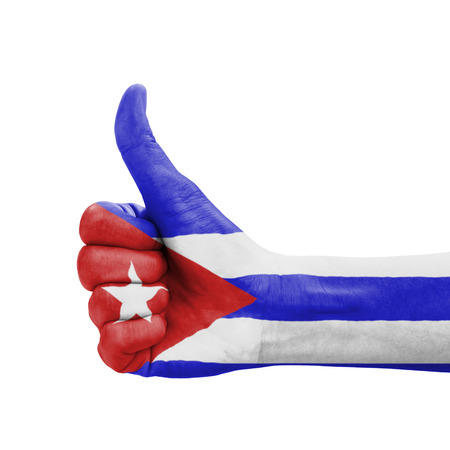 Hand with thumb up, Cuba flag painted as symbol of excellence, achievement, good - isolated on white background photo