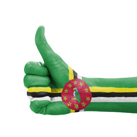 Hand with thumb up, Dominica flag painted as symbol of excellence, achievement, good - isolated on white background photo