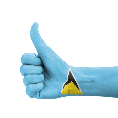 Hand with thumb up, Saint Lucia flag painted as symbol of excellence, achievement, good - isolated on white background photo