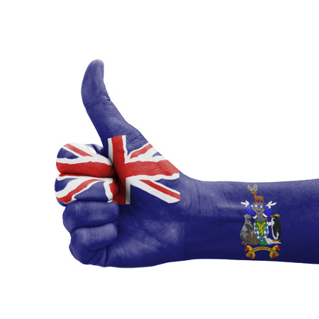 Hand with thumb up, South Georgia and South Sandwich Islands flag painted as symbol of excellence, achievement, good - isolated on white background photo