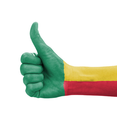 Hand with thumb up, Benin flag painted as symbol of excellence, achievement, good - isolated on white background Stock Photo