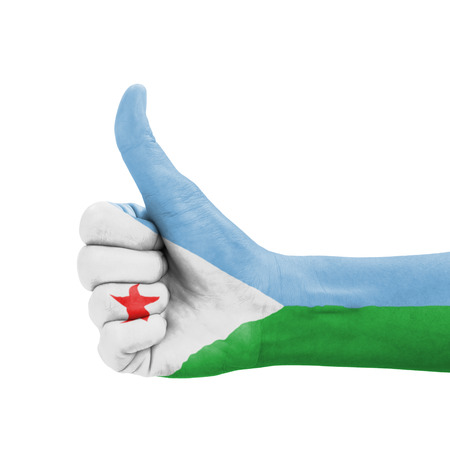 Hand with thumb up, Djibouti flag painted as symbol of excellence, achievement, good - isolated on white background photo