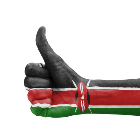 Hand with thumb up, Kenya flag painted as symbol of excellence, achievement, good - isolated on white background photo
