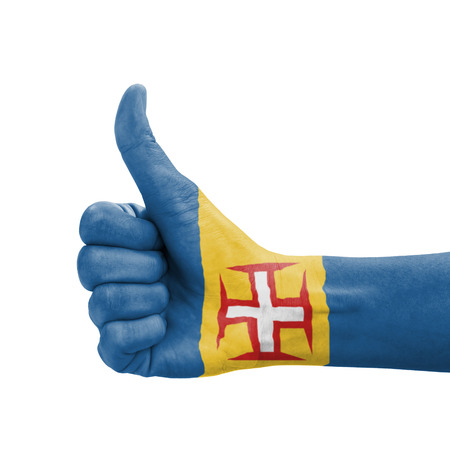 Hand with thumb up, Madeira flag painted as symbol of excellence, achievement, good - isolated on white background photo