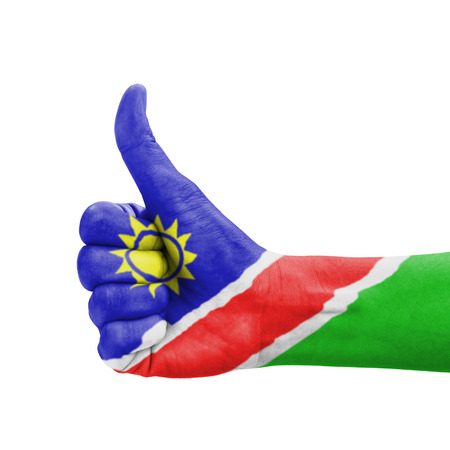 Hand with thumb up, Namibia flag painted as symbol of excellence, achievement, good - isolated on white background photo