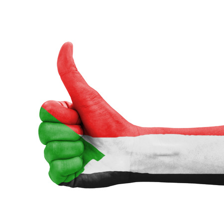 Hand with thumb up, Sudan flag painted as symbol of excellence, achievement, good - isolated on white background Stock Photo - 22228406