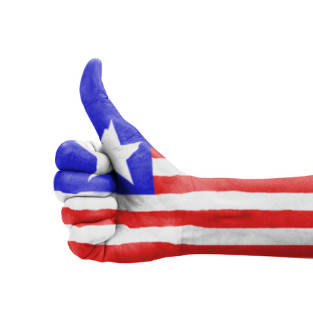 Hand with thumb up, Liberia flag painted as symbol of excellence, achievement, good - isolated on white background photo