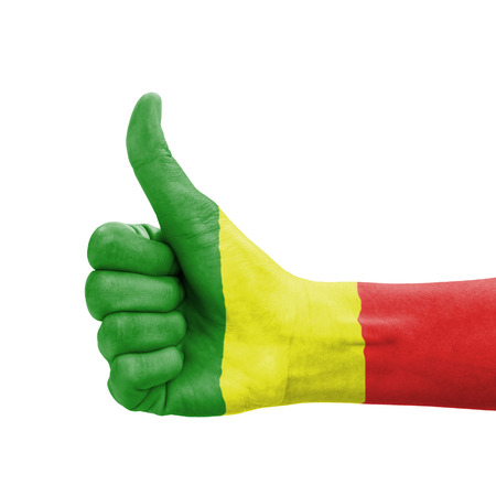 Hand with thumb up, Mali flag painted as symbol of excellence, achievement, good - isolated on white background photo