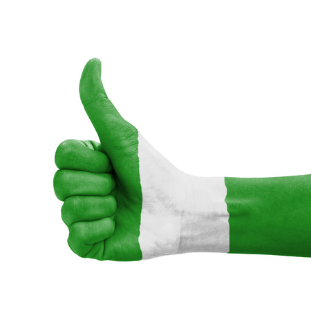 Hand with thumb up, Nigeria flag painted as symbol of excellence, achievement, good - isolated on white background photo