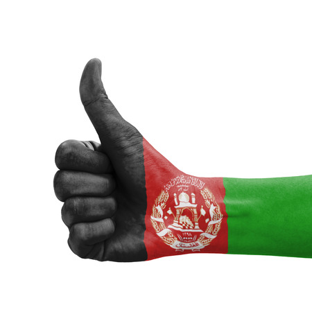 Hand with thumb up, Afghanistan flag painted as symbol of excellence, achievement, good - isolated on white background photo