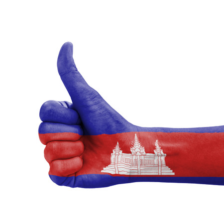 Hand with thumb up, Cambodia flag painted as symbol of excellence, achievement, good - isolated on white background photo