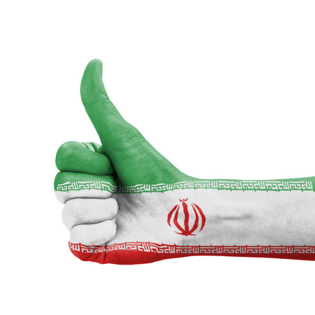 Hand with thumb up, Iran flag painted as symbol of excellence, achievement, good - isolated on white background photo