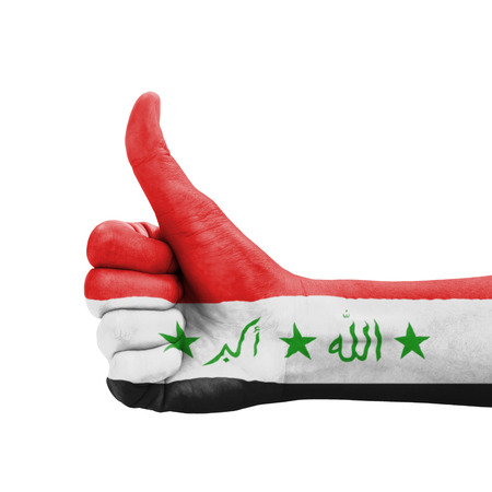 Hand with thumb up, Iraq flag painted as symbol of excellence, achievement, good - isolated on white background photo