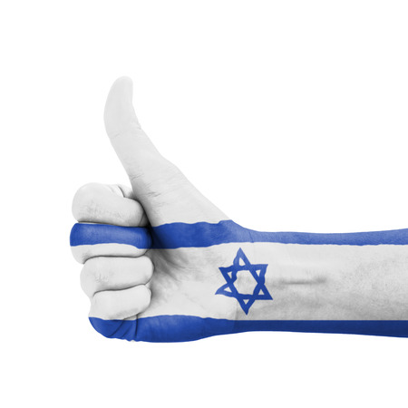 Hand with thumb up, Israel flag painted as symbol of excellence, achievement, good - isolated on white background photo