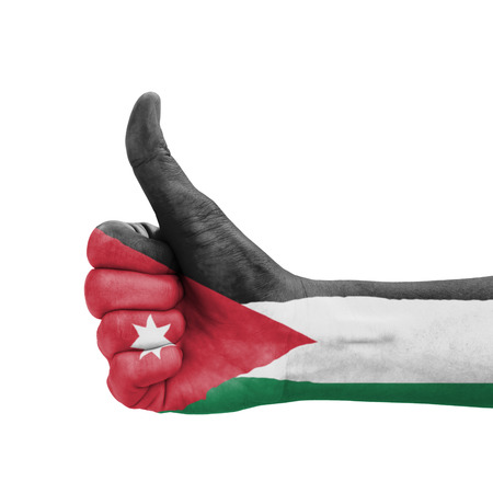Hand with thumb up, Jordan flag painted as symbol of excellence, achievement, good - isolated on white background photo