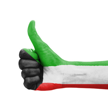 Hand with thumb up, Kuwait flag painted as symbol of excellence, achievement, good - isolated on white background photo