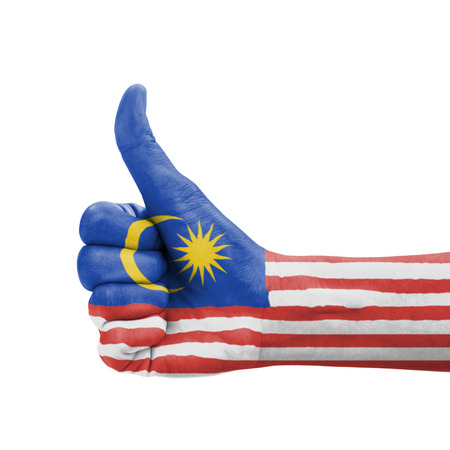 Hand with thumb up, Malaysia flag painted as symbol of excellence, achievement, good - isolated on white background