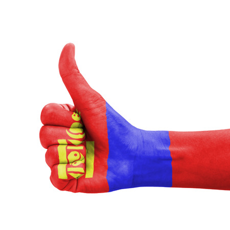 Hand with thumb up, Mongolia flag painted as symbol of excellence, achievement, good - isolated on white background photo